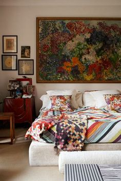 from Decor Pad    Rachel Whiting    White platform bed, art, red nightstand chest, missoni and white walls.