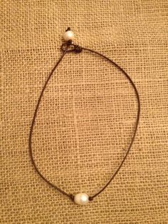 Hey, I found this really awesome Etsy listing at http://www.etsy.com/listing/158017019/simple-one-pearl-leather-necklace
