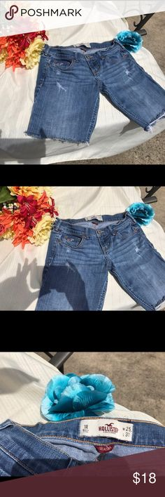 1R/25 Hollister cutoff shorts blue jean distressed 1R Hollister cutoff shorts, blue jean shorts, W 25. Cute Cutoff shorts. Size 1 Regular, Waist 25. Excellent used condition. Distressed right back pocket and a few parts in front, see pictures. Flowers not included. 😀 Approximate Measurements:       🌀Waist: 25 inches across 🌀Length: 14 inches long (a bit longer in back about 15.75), 🌀Inseam (crotch to bottom): 8 inches. Hollister Shorts Jean Shorts