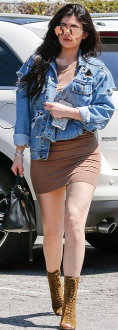 Kylie Jenner: Sunglasses – Victoria Beckham Collection  Purse – Hermes  Bracelet – Cartier  Jacket – Lambert  Shoes – Gianvito Rossi