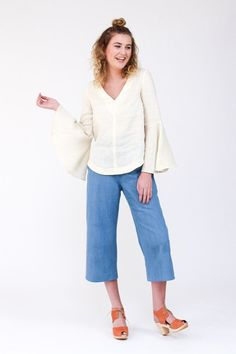 The Dove Blouse sewing pattern by Megan Nielsen is a loose-fitting blouse with varying sleeve options, french darts, a v-neckline and curved neckline.