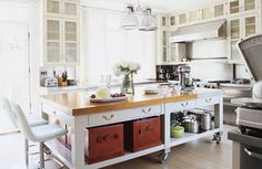 love this kitchen island on casters with a butchers block top