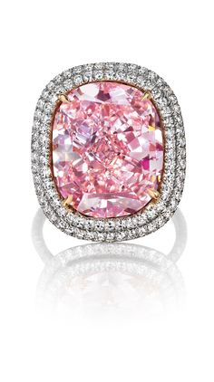 THE LARGEST CUSHION-SHAPED FANCY VIVID PINK DIAMOND AT AUCTION. Now 'THE SWEET JOSEPHINE'. Set with a cushion-shaped fancy vivid pink diamond, weighing approximately 16.08 carats, within a diamond twin surround, to the pink diamond gallery and diamond-set hoop, ring size 6, mounted in platinum and gold. Price Realized $28,763,150 // Estimate $23,000,000 - $28,000,000. GIA / Fancy Vivid Pink colour, VVS2 clarity. Type IIa diamond [C. GE. 10 NOV. 2015] #SweetJosephine #FancyVividPink #Diamond