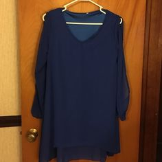 Royal blue blouse Royal blue, v-neck blouse. Sleeves split from shoulder to cuff. Sheer material, bodice fully lined. Tops Blouses
