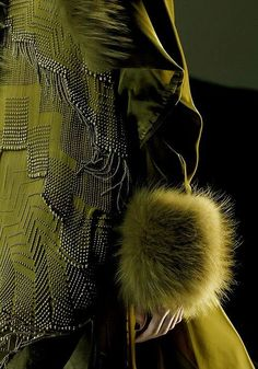 Jean Paul Gaultier and Olive http://nomadicdecorator.com/2015/04/10/color-story-olive/