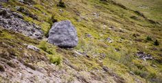 The boulder is actually a small house in the Swiss Alps