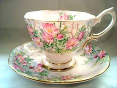 Love pink roses...and red roses... and yellow roses.....roses in general, especially when they are on a tea cup!