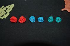 orecchini chiodino a forma di rosa in fimo di vari colori realizzata interamente a mano. se vi piace venite a visitare la mia pagina facebook:) : https://www.facebook.com/Fiumi-Di-Fimo-429219753934180/  https://www.etsy.com/it/shop/FiumidiFimo?ref=hdr_shop_menu  #orecchini #chiodino #earrings #rose #roses #varicolori #rosso #verdemare #celestecielo #eleganti  #fattoamano #fattoamanoconamore #handmade #artigianato #fimo #fimocreazioni #creazioni #creations #polymerlay #idearegalo #creations