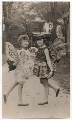 2 such sweet butterflies!!! wouldn't it be fab to know the year? house in background looks like NY suburb? their names? how did their lives turn out? but precious pin!!!!!