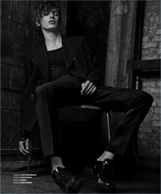Appearing in an editorial for Essential Homme, Lucas Satherley wears a Dolce & Gabbana jacket with a Rick Owens t-shirt, Prada trousers, and Dior Homme shoes.