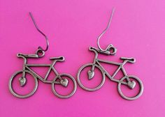 These unique little bicycle earrings are available in either a bronze or silver… Belly Button Rings, Bicycle, Bronze, Metal, Unique, Earrings, Silver, Gold, Jewelry