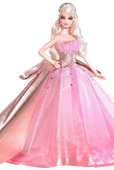 10 Holiday Barbie Gowns We'd Love to See on a Pageant Stage |Velvet is making a comeback in the evening gown scene and the 2004 Holiday Barbie embraced this fabric wholeheartedly.  She rocked this gown in two colors in 2004.  She also wore it in a dark evergreen and maroon rather than traditional holiday red.  Read more: http://thepageantplanet.com/10-holiday-barbie-gowns-wed-love-to-see-on-a-pageant-stage/