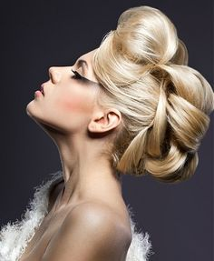 A long blonde straight coloured sculptured updo hairstyle by Web Collection