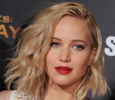 Lawrence's makeup only got more spectacular at each of this year's The Hunger Games: Mockingjay Part 2 premieres. We're crowning this one the winner, though: Makeup artist Jillian Dempsey gave the star a starkly dramatic red-lips/white-rimmed-eyes combo for the Los Angeles stop on the tour.