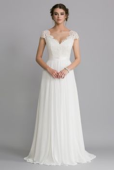 OCA614T DELILAH  The corded lace creates a sheer v-neckline over a satin bodice. Fitted lace cap sleeves sit neatly over the shoulders, and the waist is finished with a satin sash.