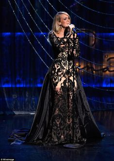 Gothic style: The former American Idol winner later swapped into a magnificent black lace and partly sheer gown for another performance American Country Music Awards, Country Music Artists, Country Singers, Sheer Gown, Wonderwall, Stage Outfits, American Idol, Carrie Underwood, Gothic Fashion