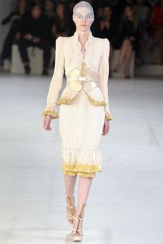 Anyone else remember the Aeon Flux movie a few years back, the one with Charlize Theron? There's an outfit she wears towards the beginning of the movie that looks like this in muted purple, and now that is all I can think of when I view the rest of this collection. (Alexander McQueen S/S 2012 RTW, source: Women's Wear Daily)