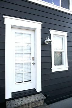 Door & Window Trim - black and white benjamin moore exterior paint and industrial sconce light / sfgirlbybay House Design, Exterior Paint Colors For House, House, House Entrance, White Windows, Windows Exterior, Exterior Doors, Window Trim Exterior, Exterior Trim