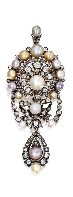 Silver-Topped Gold, Pearl and Diamond Pendant-Brooch, France. The fan-shaped top supporting a pear-shaped pendant, spaced by a bow, set with two white natural pearls, with one gray button-shaped natural pearl, accented by 15 additional pearls of various hues, further set with old mine and rose-cut diamonds, with French assay and workshop marks; circa 1870.