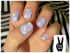 I love the 80's geometric look of these nails!