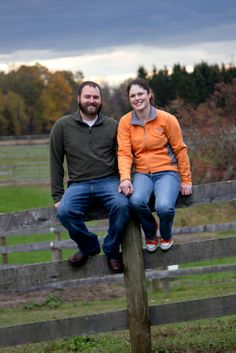 A couple sitting on an old wooden fence.Copyright Photographics Solution 2011