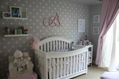 Pink and Gray Nursery featuring a fun polka dot accent wall