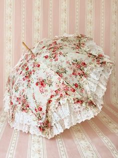 Shabby chic rose covered parasol.~Add a layer of lace and then fabric over the battenberg lace parasol I already have.  :)