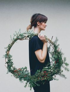 Skip the size constraints of a wreath form, and tie evergreen branches together with wire to create a piece that's nearly larger than life. Get the tutorial at Treasures & Travels »