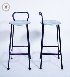 "Indy Low Back Stool        greige studio collection      seating        Hand made of steel with galvanized seat      Seat height 27""      Back height 33""      Seat Dia. 13.5""      Distressed raw steel finish      Please allow 2-3 weeks"