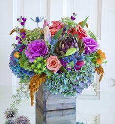 This abundant mix celebrates the season and bring the garden harvest indoors.  $149.00