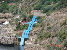 OMG, i have to try this .  Superslide straight into the Mediterranean Sea. Citt del Mare Hotel, Sicily
