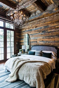 Love this rustic farmhous with the glamorous restoration hardware chandelier. #reclaimedwood #beetlekill #restorationhardware #bedroom