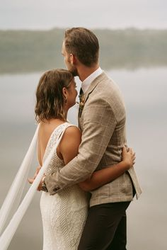 """A little rain never hurt anybody! We can't get enough of these intimate lakeside """"I do's."""" Search """"Relaxed Rainy-Day Lakeside Elopement"""" on the blog! 