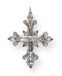 AN IMPORTANT ANTIQUE DIAMOND CROSS PENDANT Each arm set with a hogback-cut diamond, enhanced by pear and old mine-cut diamond trefoil motif terminals, further accented by old mine-cut diamonds, mounted in silver and gold, circa 1790