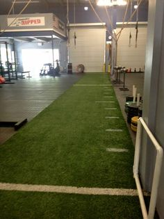 Indoor turf grass for garage gym.