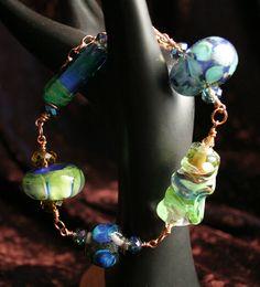 Wire wrapped lampwork beaded bracelet.