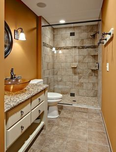 Brown wall color with stone tile texture for small bathroom