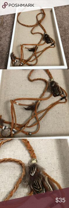 Braided choker feather necklace This awesome leather piece is handmade and one of a kind! Has a braided leather wrap with feathers and beads on the end. Can wear multiple ways and is so cute with everything! Loving this boho style wrap necklace  Accessories