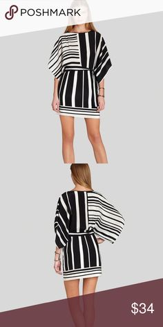 BCBG black & white kimono silk dolman dress Black and white BCBG silk dolman kimono dress.  Worn once and just dry cleaned.  Great for work and cocktails.  Must have!  Size small.  Runs a bit big. BCBGMaxAzria Dresses Mini