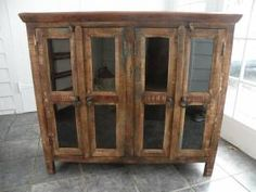 Reclaimed wood sideboard with glass doors.