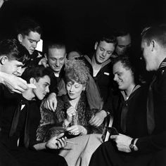 Lucille Ball signs autographs for admiring seamen at one of the January 1944 galas celebrating President Franklin D. Roosevelt's 62nd birthday.