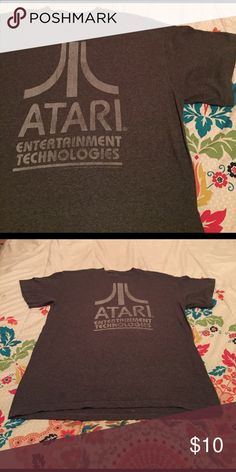 Atari shirt This Atari shirt is perfect for your inner gamer or maybe just a shirt is show off. feel free to ask me any questions :) Shirts Tees - Short Sleeve