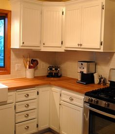 kitchen makeover: beadboard kitchen cabinet doors with butcher block counters and subway tile backsplash