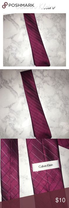 Calvin Klein Tie Men's Calvin Klein Tie, gently used with no flaws. Great condition, made of 100% silk. Dark red/maroon/burgundy color Calvin Klein Accessories Ties