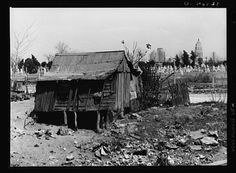 Looking towards central downtown San Antonio, with Smith Young tower in background, Mexican cemetery in middle ground and Mexican house in foreground. March 1939. From America from the Great Depression to World War II: Black-and-White Photographs from the FSA-OWI, 1935-1945