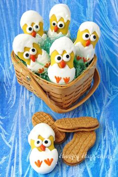 This Easter fill your baskets with some a adorably cute white chocolate Nutter Butter Hatching Chicks. See the step-by-step tutorial to make your own.