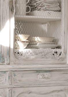 White interior design; white washed cupboard; wire mesch doors; antique cupboard; white renovated vintage cupboard