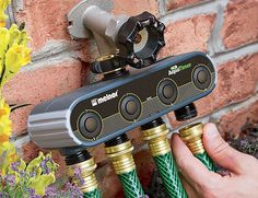 The AquaTimer easily screws into place on the spigot. On the bottom are four spaces for your hoses which can all be individually controlled, allowing you to water up to four zones independently.
