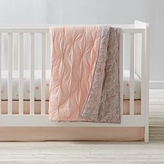 Add an instant touch of elegance to any nursery with our Modern Chic Crib Bedding. This stunning bedding set features a baby quilt that's gathered and quilted for a truly delicate look. It even reverses to a gorgeous floral print. And the Crib fitted Sheet is made from super cozy 100% cotton percale.