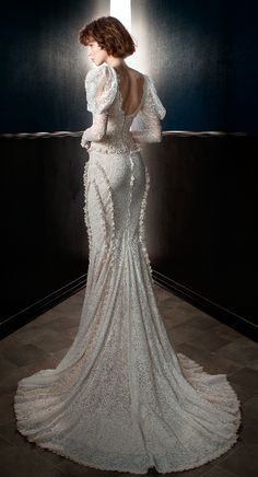 The Charlie. A sculptural French lace mermaid gown with Victorian mutton sleeves, a V neckline and multiple seams with a rouched lace frill detail. The gown has a matching waist cincher made of an antique embroidered lace with a Victorian rose motif. #wedding #dress #couture #bride